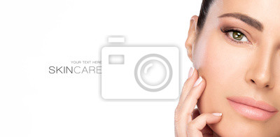 Fototapeta Beauty and Skincare Concept. Beautiful natural young woman face with nude makeup on a flawless skin