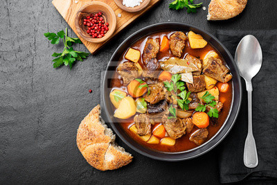 Fototapeta Beef meat  stewed with potatoes, carrots and spices (hungarian goulash).
