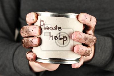 Fototapeta Bezdomny mężczyzna prosi o pomoc, na czarnym tle z bliska