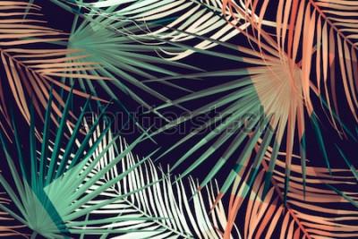 Fototapeta Bezszwowe tropikalny wzór liści palmowych. Tło z liści palmowych w stylu botanicznym. Stylowy nadruk tropików. Wzór mody tropikalnych liści.