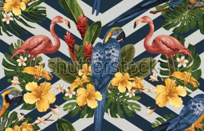 Fototapeta Bezszwowy tropikalny deseniowy tło z tropikalnymi kwiatami, ary i flaminga błękitnymi i żółtymi ,. Tropikalna ilustracja w stylu vintage hawajski.