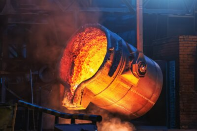 Fototapeta Big ladle container with molten liquid metal or iron in foundry close up.