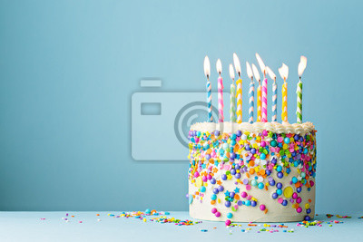 Fototapeta Birthday cake decorated with colorful sprinkles and ten candles