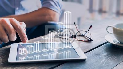 Fototapeta Biznesmen analizuje rosnący wykres 3D AR nad ekranem tabletu