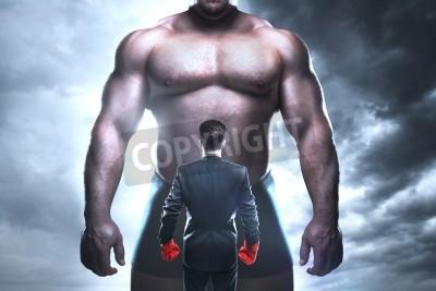 Fototapeta biznesmen boks przed wielkim mięśni człowieka