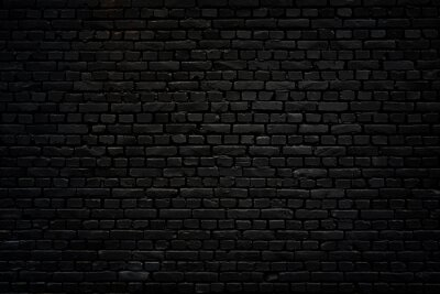Fototapeta Black brick wall as background or wallpaper or texture