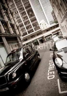 Fototapeta Black cab London taxi car in the City