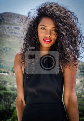 Fototapeta Black woman with red lips looking at camera