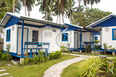 Fototapeta Blue and white holiday houses in green paradise landscape