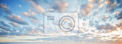 Fototapeta Blue sky clouds background. Beautiful landscape with clouds and orange sun on sky