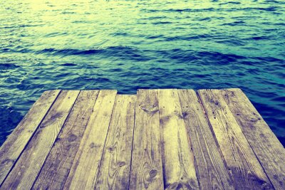Fototapeta Blue water with empty wooden platform