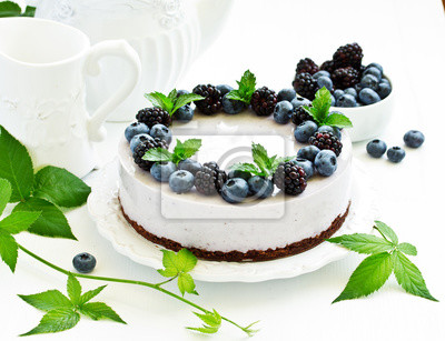 Fototapeta Blueberry cheesecake without baking, with blueberries and blackberries.
