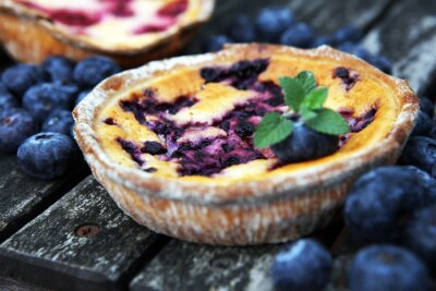 Blueberry pie or homemade cheesecake with blueberries. Delicous dessert blueberry tart