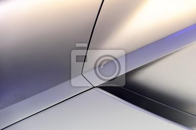 Fototapeta Błyszczały powierzchnia potężny samochód sportowy tytanu aerodynamicznym nadwoziem z fragmentu wlotu powietrza