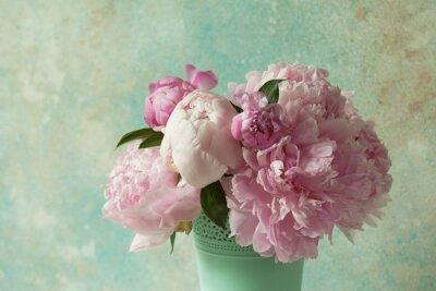 Fototapeta Bouquet of pink peonies in a vase on a light colored background
