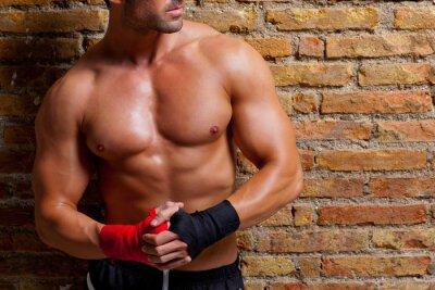 Fototapeta boxer kształcie mięśni człowiek z bandażem na pięści