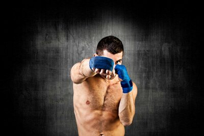 Fototapeta Boxer on dark background