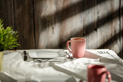 Breakfast on the table in the light of the morning sun