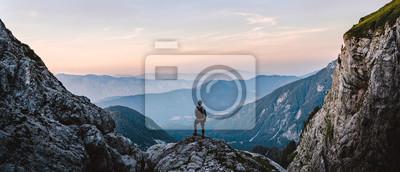 Fototapeta Breathtaking Views From Mangart Peak at Stunning Sunrise. Peaks Above Clouds.