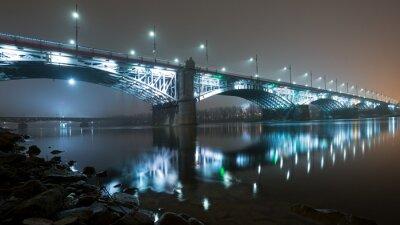 Fototapeta Bridge illuminated at night in the fog. Poniatowski Bridge