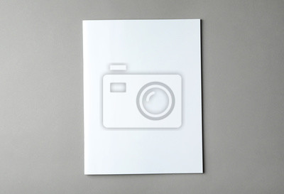 Fototapeta Brochure with blank cover on grey background, top view. Mock up for design