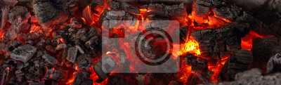 Fototapeta Burning coals from a fire abstract background.