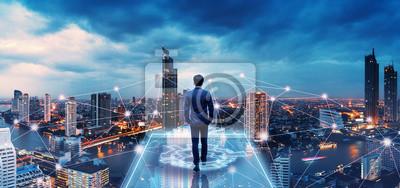 Fototapeta Business man on future network city
