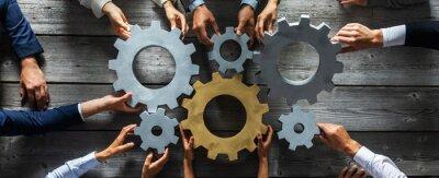 Fototapeta Business people joining gears