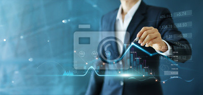 Fototapeta Businessman draw growth graph and progress of business and analyzing financial and investment data ,business planning and strategy on blue background.