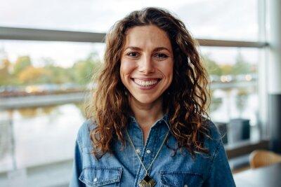 Fototapeta Businesswoman smiling in office