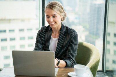 Fototapeta businesswoman working on her laptop