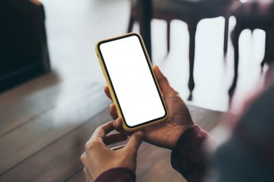 Fototapeta cell phone blank white screen mockup.woman hand holding texting using mobile on desk at office.background empty space for advertise.work people contact marketing business,technology