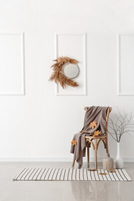 Fototapeta Chair and beautiful autumn decor in interior of light room