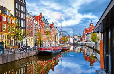 Fototapeta Channel in Amsterdam Netherlands houses river Amstel landmark old european city spring landscape.