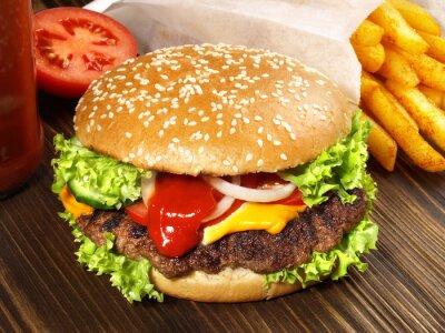 Fototapeta Cheeseburger mit Pommes Frites
