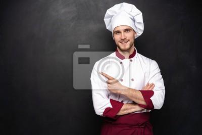 Fototapeta Chef presents something on a black background.