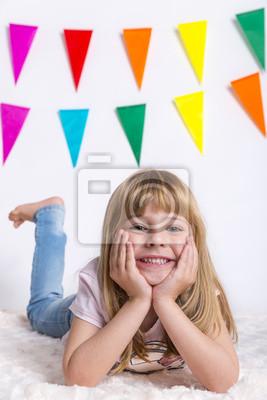 child blonde happy girl in pink shirt