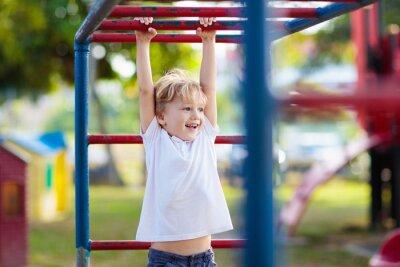 Fototapeta Child on playground. Kids play outdoor.