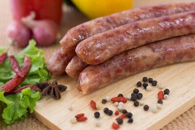 Fototapeta chinese sausages on chopping block