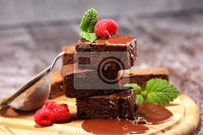 chocolate brownie cake dessert with raspberry and spices on a rustic background
