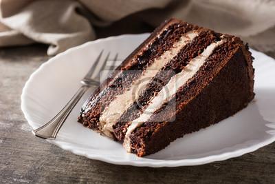 Fototapeta Chocolate cake slice on wooden table