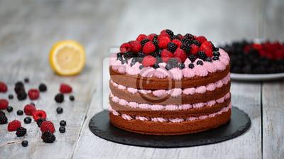Fototapeta Chocolate cake with summer berries.