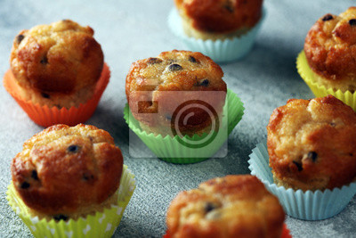 Chocolate muffin and nut muffin, homemade bakery on beautiful rustic background
