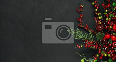 Fototapeta Choinek banches i czerwony jagody tło