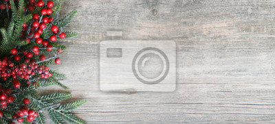 Fototapeta Christmas Holiday Evergreen Pine Branches and Red Berries Over Wood Background, Copy Space
