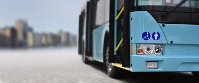 Fototapeta City bus on background city skyline
