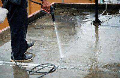 Fototapeta Clean the cement floor with a high-pressure cleaner. Deck floor, crack.