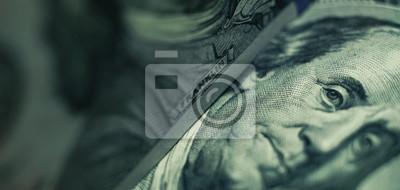 Fototapeta Close up Franklin's face  on a one hundred dollar. American, US Dollars Cash Money background.