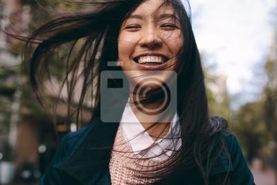 Fototapeta Close up of a smiling asian woman