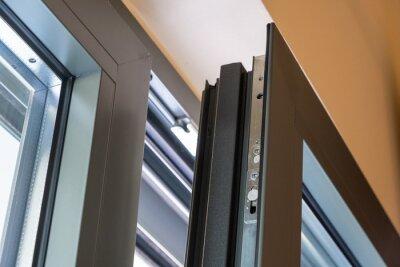 Fototapeta Close up of aluminum door window, blurry background